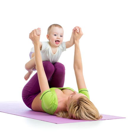 mother with baby doing gymnastics photo