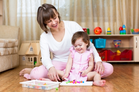 mother and kid play together Stock Photo - 24749535