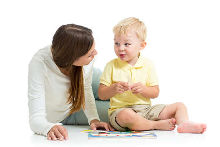 child boy and mother play together solve puzzle toy photo