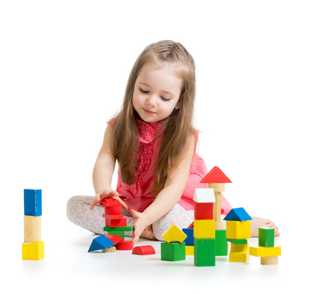 child girl playing with colorful building block toys photo