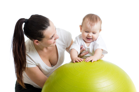 mother doing gymnastics with baby  on fitness ball Stock Photo - 24798154