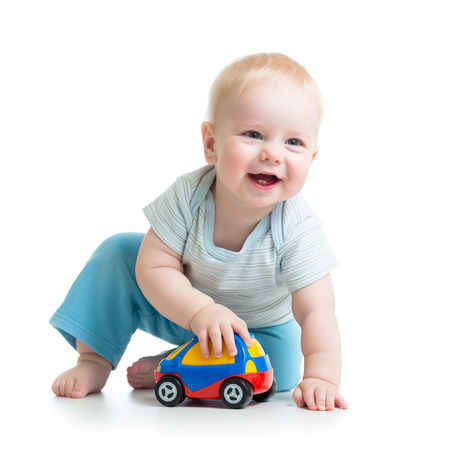 smiling kid playing with toy Stock Photo