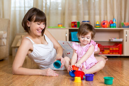 kid and mother play together with cup toys Stock Photo - 24881076