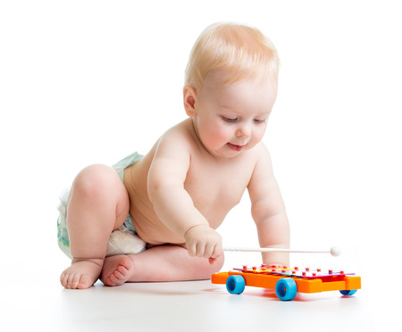 baby boy playing with musical toys photo