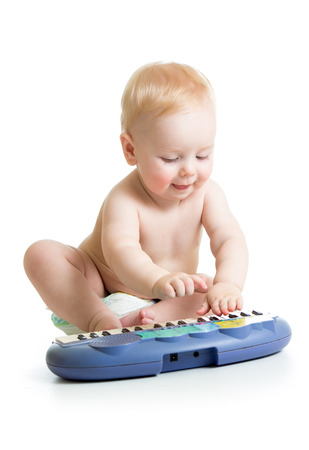 adorable child boy playing electronic piano photo