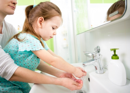 clean hands: kid washing hands with mom