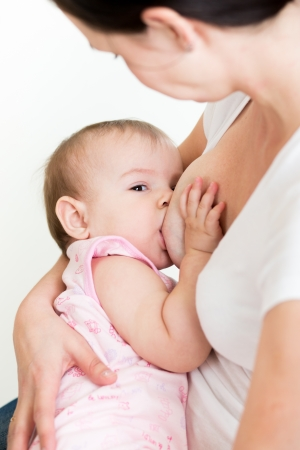 mother breast feeding her kid Stock Photo