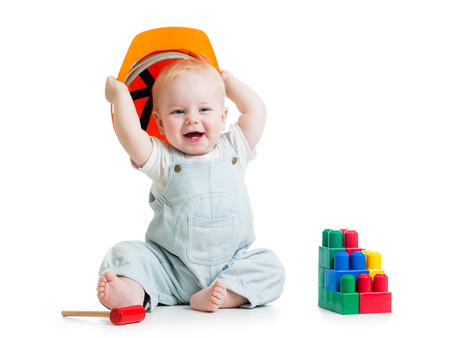 child with hard hat and building blocks photo