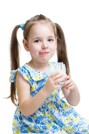 funny kid drinking yogurt or kefir isolated on white