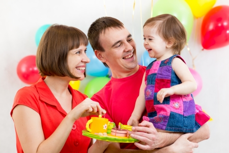 young family celebrating first birthday of baby girl Stock Photo - 25067338