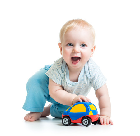 funny boy kid playing with toy car photo