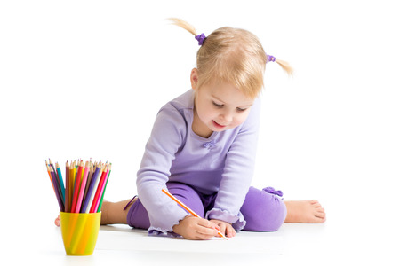 kid drawing with color pencils photo