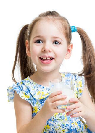 kid girl drinking yogurt or kefir over white photo