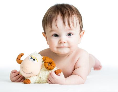 baby boy lying on tummy with lamb toy Stock Photo