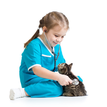 Kid girl playing doctor with kitten isolated photo