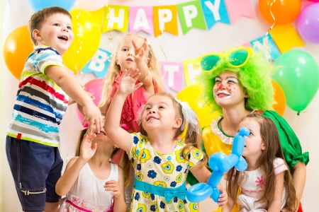 children celebrating  birthday party  merrily photo