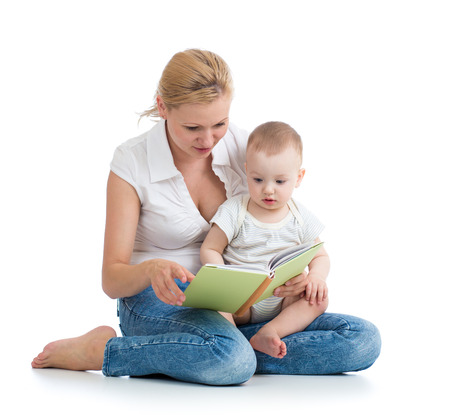 mother reading a book to her baby son photo