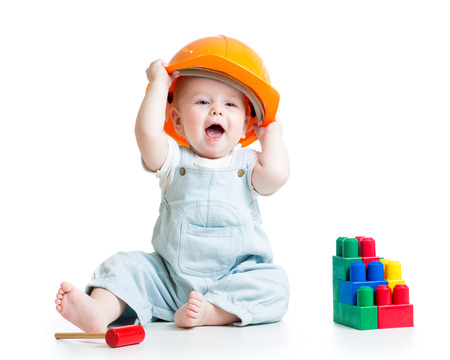 baby playing with building blocks toy photo