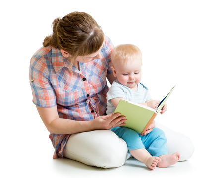 mother reading a book to her baby boy photo