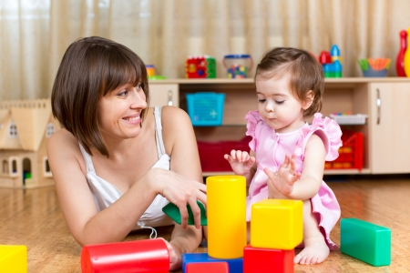 mom and kid play toys indoors photo