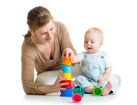 kid and mother playing together with toys photo