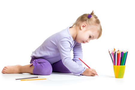 kid girl drawing with colourful pencils photo