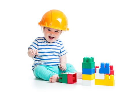 baby playing with building blocks toys photo