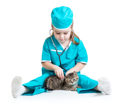 Child girl playing doctor with cat isolated photo
