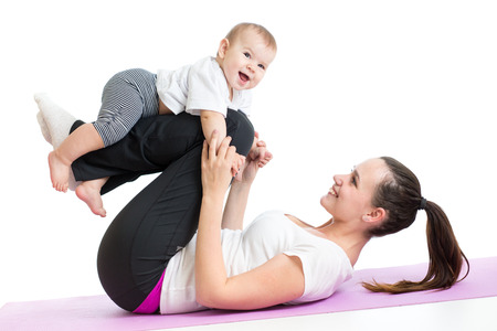 mother with baby doing gymnastics and fitness exercises photo