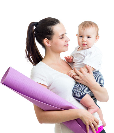 Mother going to do fitness exercises with her baby photo
