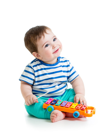 Nice baby playing  with musical toys Stock Photo - 25298402
