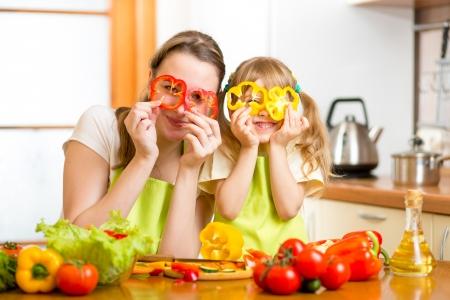 preparing food: mother and kid preparing healthy food and having fun Stock Photo
