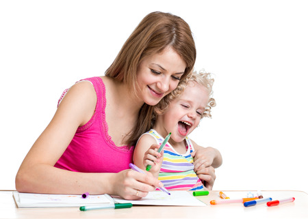 Mother and kid painting together photo