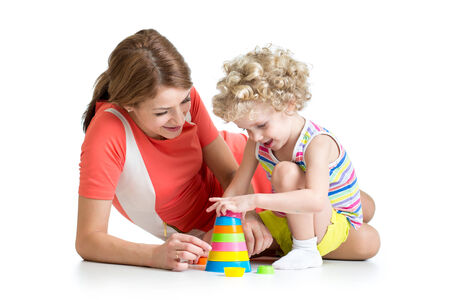 kid girl and mother play together with cup toys photo