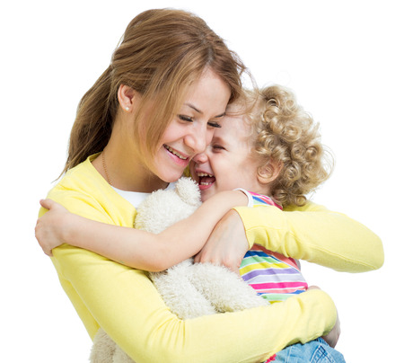 hugging mother and kid girl photo