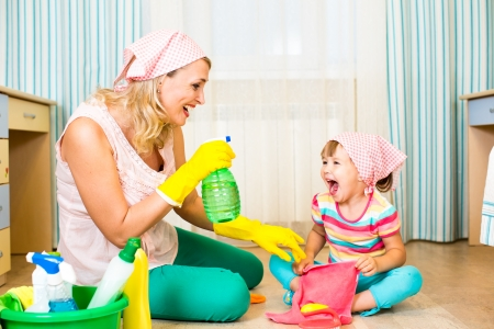 working mother: mother with kid cleaning room and having fun Stock Photo