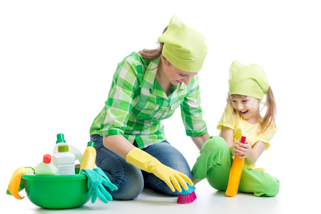 young housewife mother and her kid do homework together photo