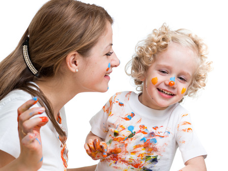 mother and kid girl painting together photo