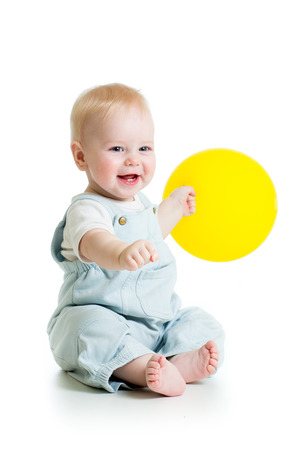 air baby: Happy baby boy with yellow ballon isolated on white