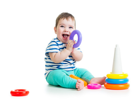 child playing with colorful toy isolated on white photo