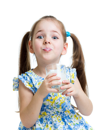 funny child girl drinking yogurt or kefir over white photo