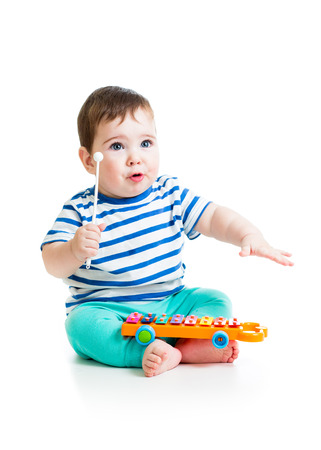 Cute baby playing  with musical toys photo