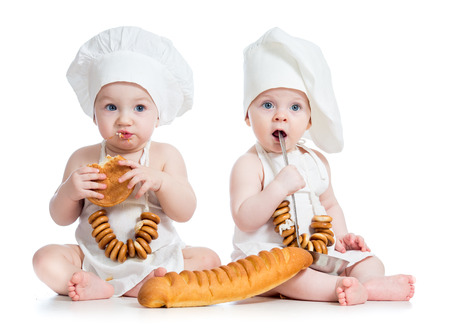 Little bakers kids boy and girl isolated photo