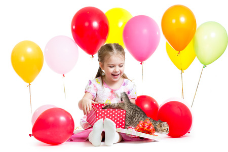 surprised child with kitten in gift box photo