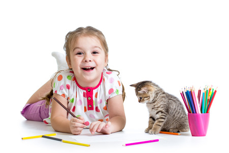 kid girl drawing with pencils and playing with cat