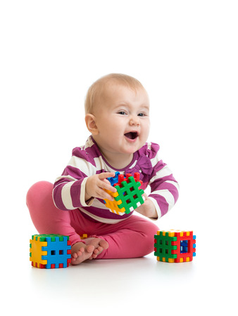 kid girl playing toy blocks  isolated on white background photo