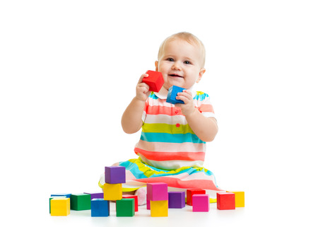 baby playing with block toys photo