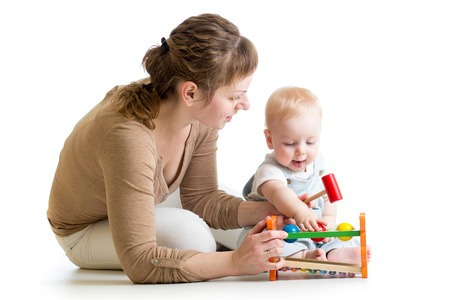 baby boy and mother playing together with toy photo