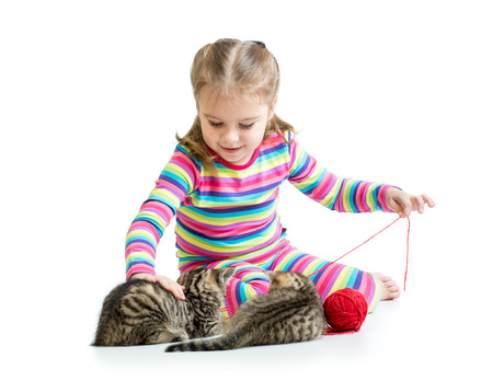 child girl playing with kittens isolated on white  photo