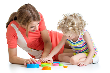 kid girl and her mom play together with cup toys photo
